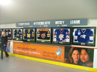 Photo of Pennsylvania High School hockey jerseys used to decorate the Civic Arena concourse.