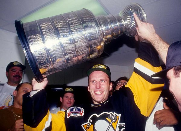 Photo of Pittsburgh Penguins goalie Tom Barrasso hoisting the Stanley Cup trophy in 1991.