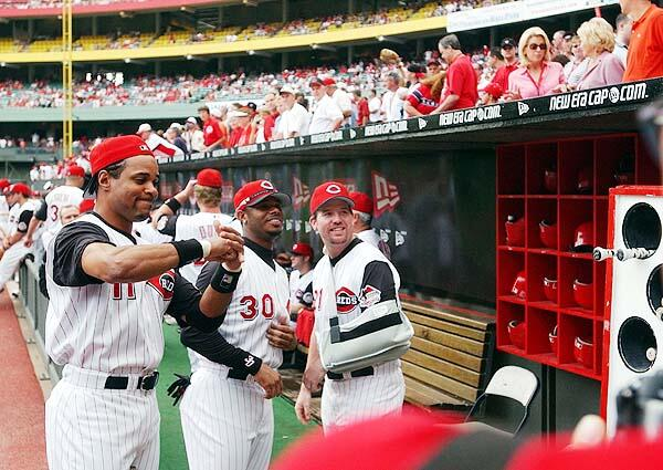 Photo of Barry Larkin and Ken Griffey Jr. in the Cincinnati Reds Dugout at Cinergy Field.