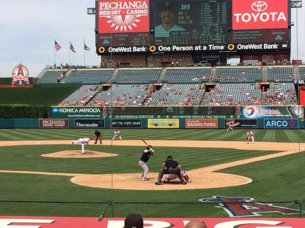 Photo of Angel Stadium of Anaheim from behind home plate during a Los Angeles Angels game.