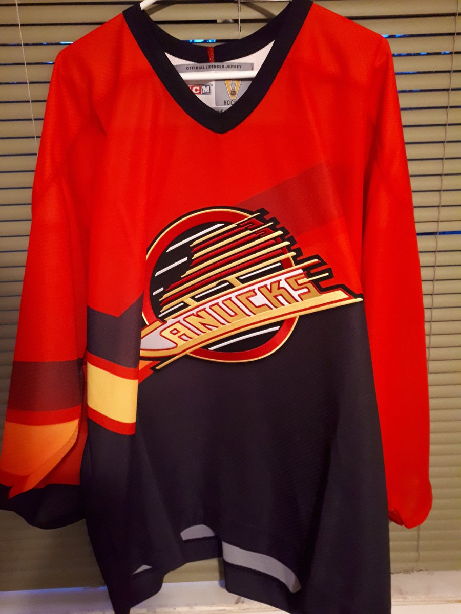 Vancouver Canucks salmon jersey.