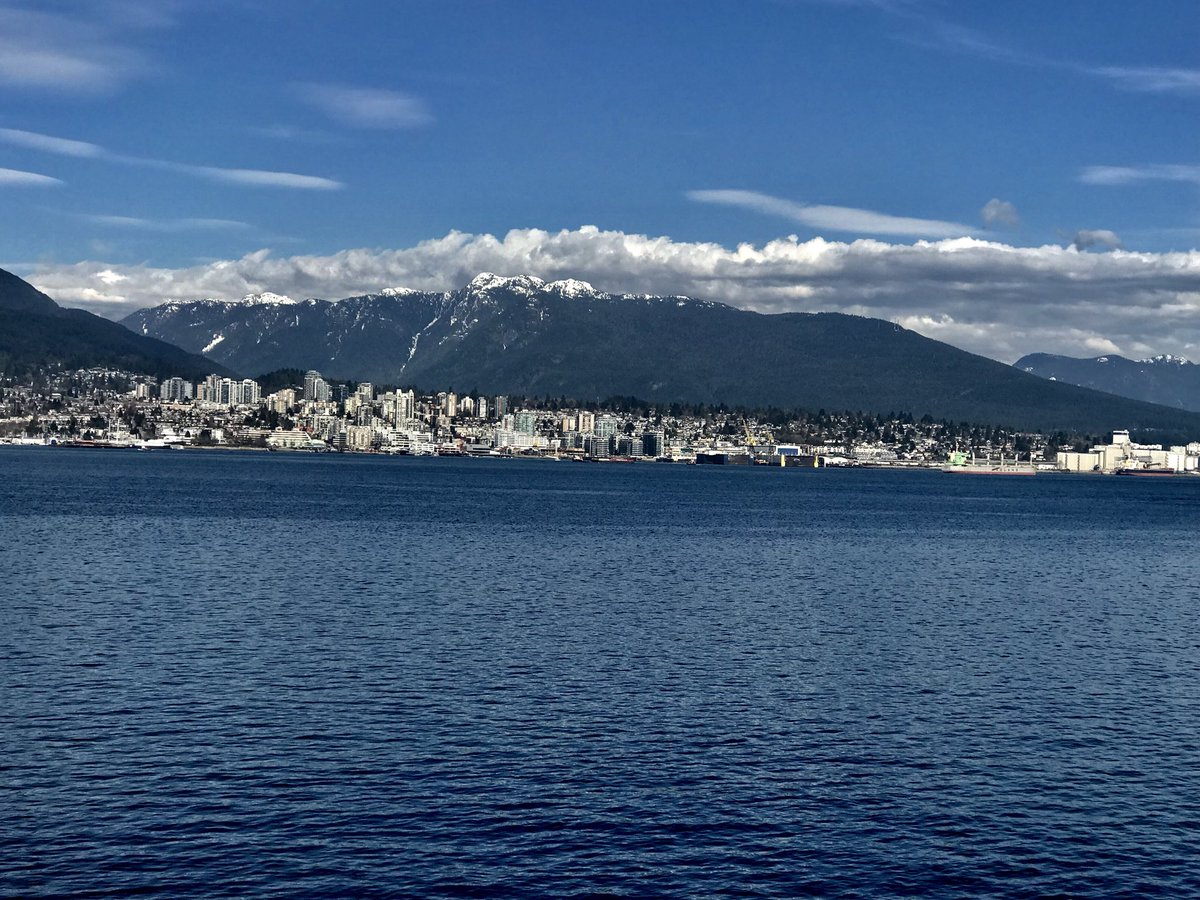 Photo of the downtown Vancouver skyline from the Pacific ocean.