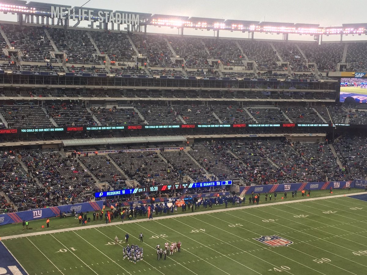 Photo of empty seats at Metlife Stadium during a New York Giants game.