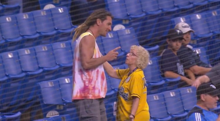 Photo of John Jaso talking to an usher at Tropicana Field.
