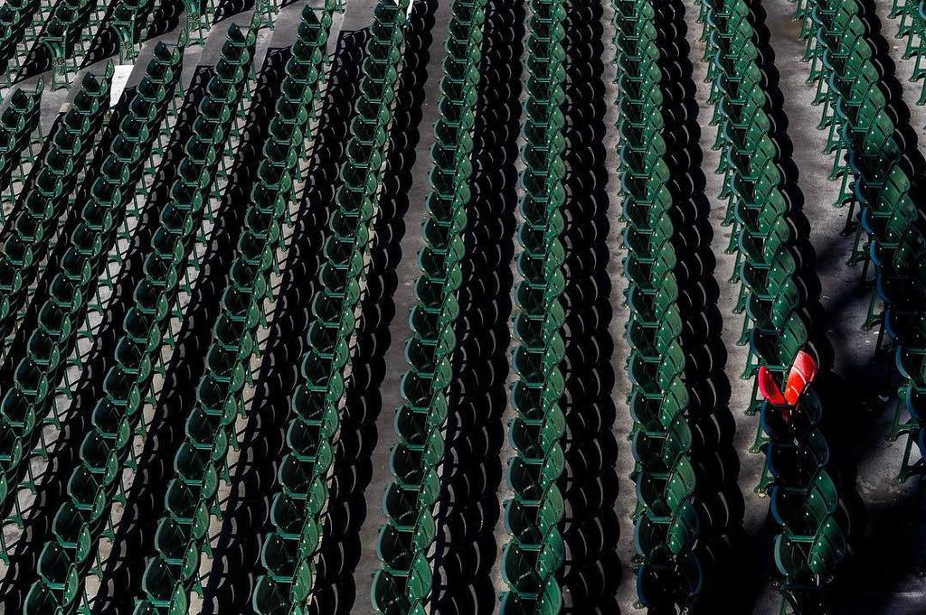 Photo of the lone red seat at Fenway Park. Home of the Boston Red Sox.