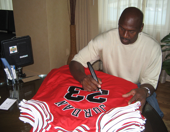 Photo of Michael Jordan Signing Autographs.