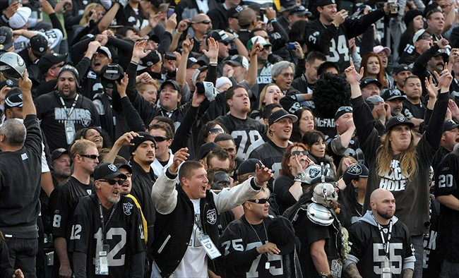 Photo of Oakland Raiders fans at Oakland Coliseum.