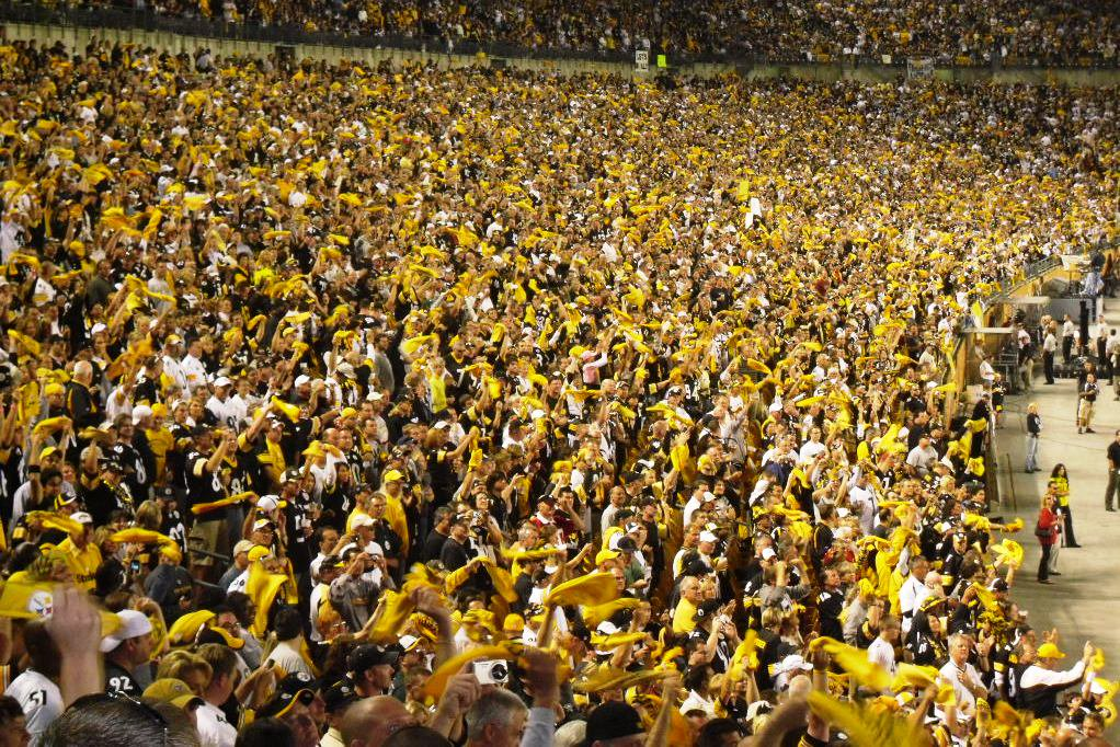 Pittsburgh Steelers fans waving Terrible Towels at Heinz Field
