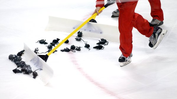Ice Crew cleaning up plastic Rats at the BB&T Center