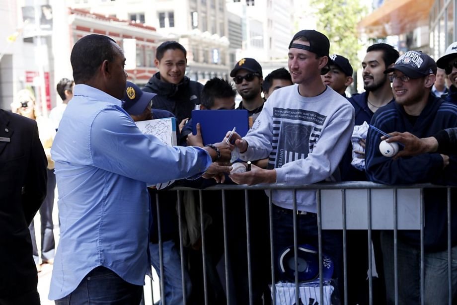 Photo of a professional athlete signing an autograph.