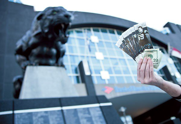 Photo of a ticket scalper outside of Bank of America Stadium in Charlotte, North Carolina.