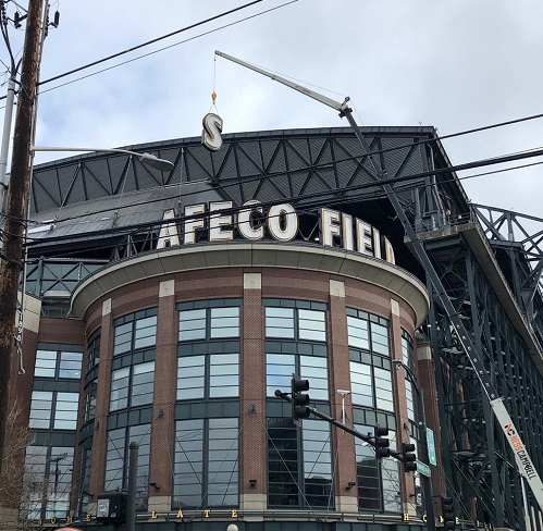 Photo of the Safeco signage at T-Mobile Park being removed.