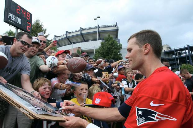 Tom Brady signing autographs at Patriots Training Camp.
