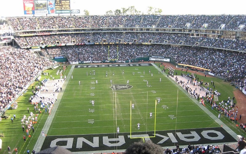 Photo of the playing field at Oakland Coliseum during an Oakland Raiders game.