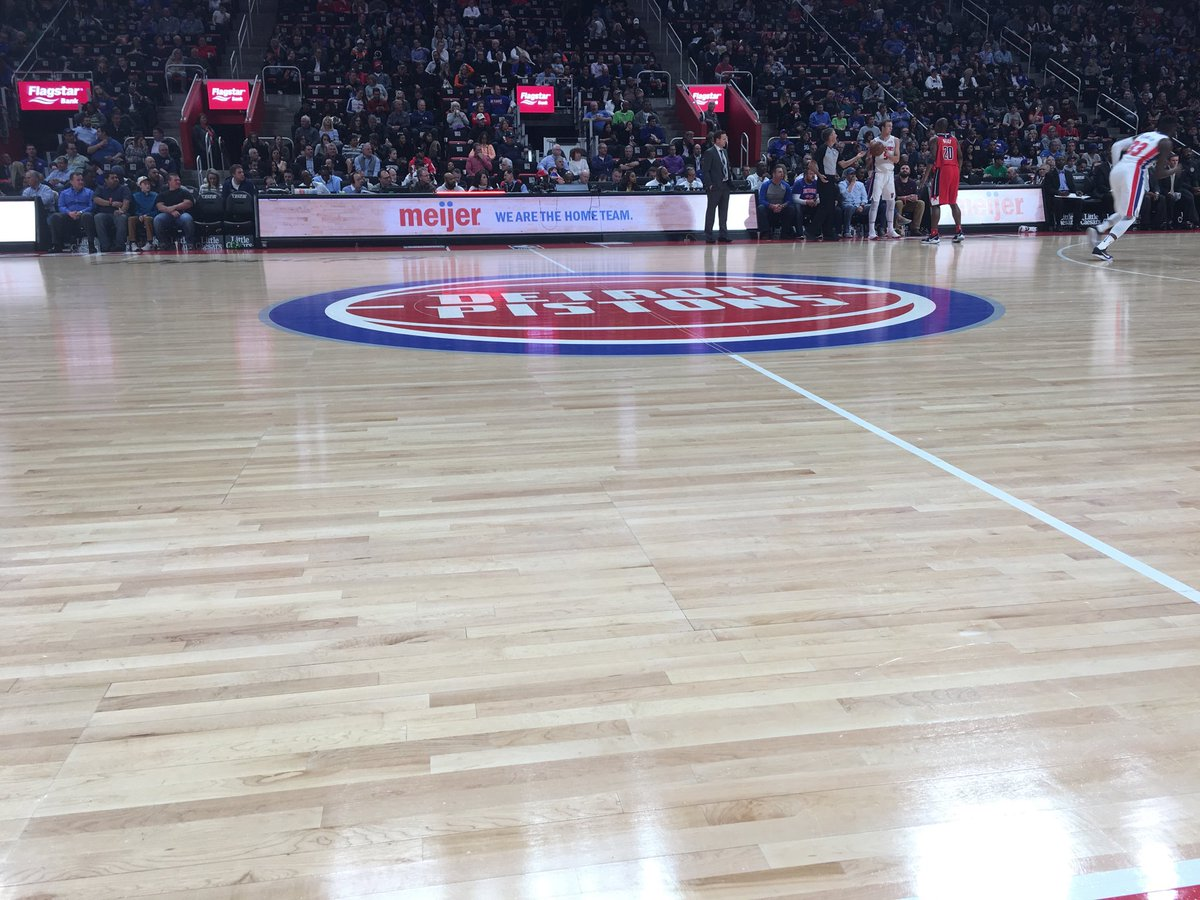 View from the courtside seats at Little Caesars Arena during a Detroit Pistons game.