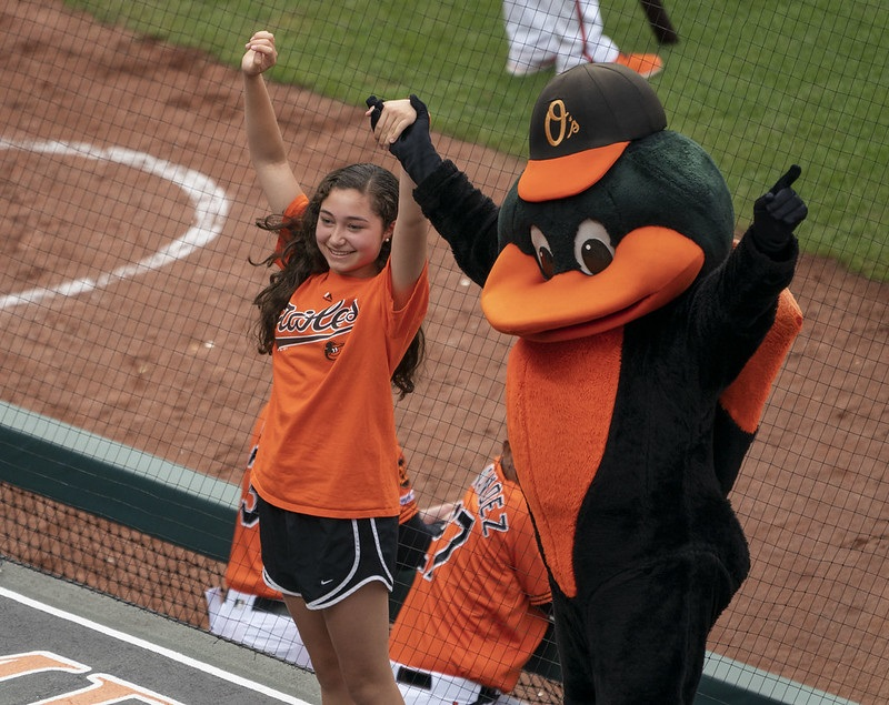 Photo of the Baltimore Orioles mascot with a young fan.