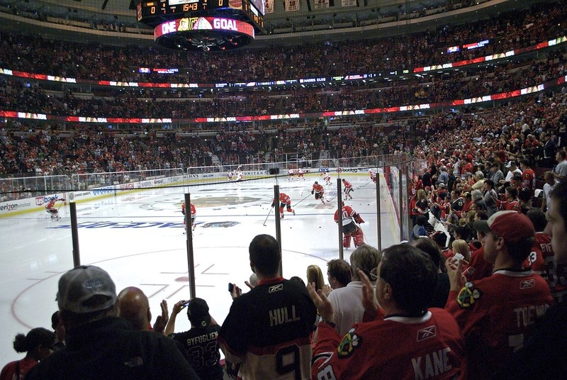 Photo of Chicago Blackhawks fans cheering at the United Center.