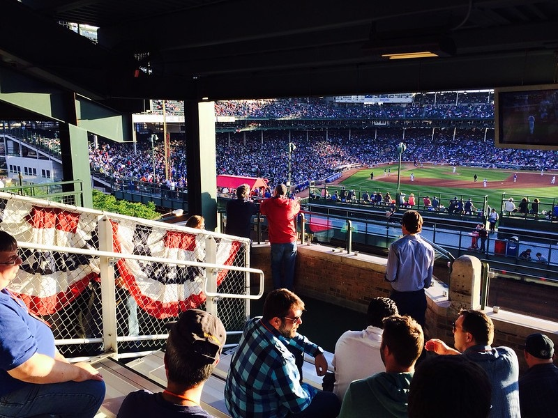 Photo of a Chicago Cubs home game at Wrigley Field from the Wrigleyville rooftops.