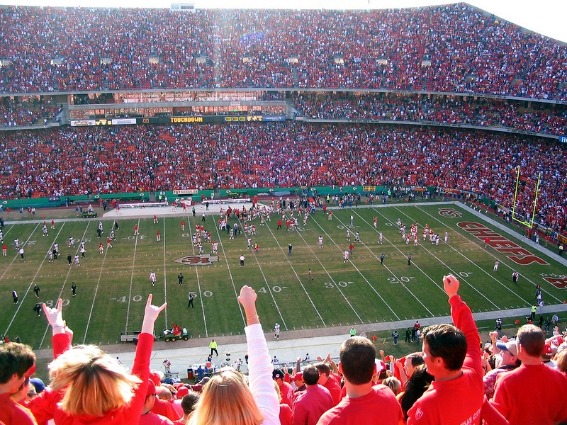 Photo of Kansas City Chiefs fans cheering at Arrowhead Stadium.