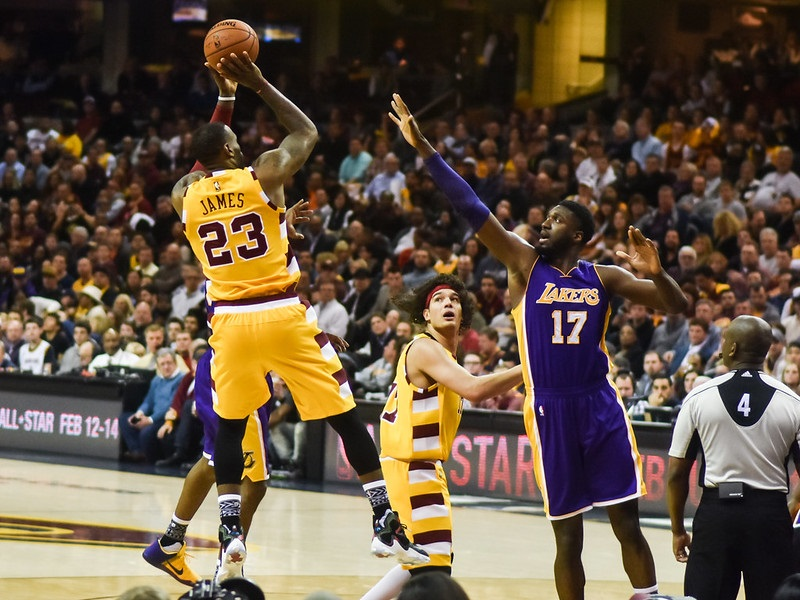 Photo of Lebron James shooting a jumpshot at Quicken Loans Arena versus the Los Angeles Lakers.
