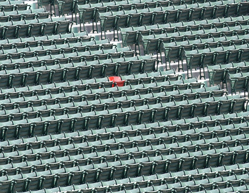 Photo of the lone red seat in the outfield bleachers of Fenway Park. Home of the Boston Red Sox.
