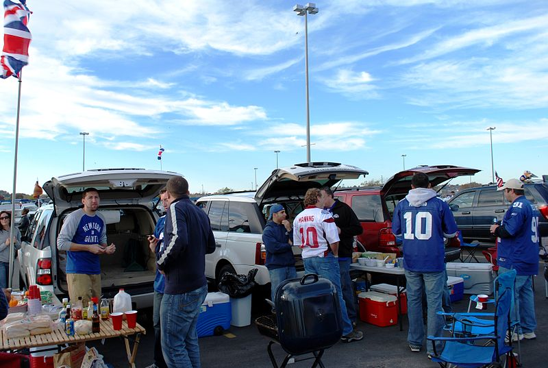 Photo of New York Giants fans tailgating outdoors.