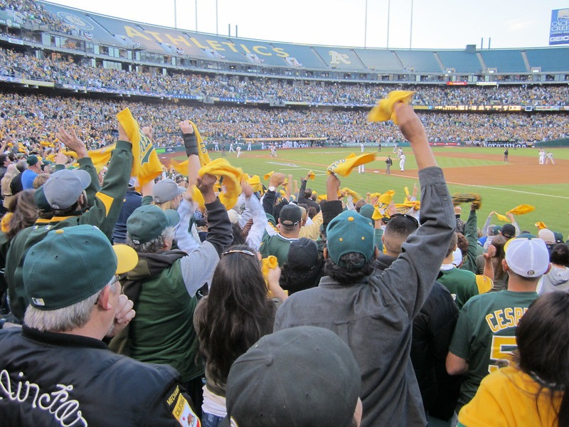 Photo of cheerful Oakland Athletics fans at Oakland Coliseum.