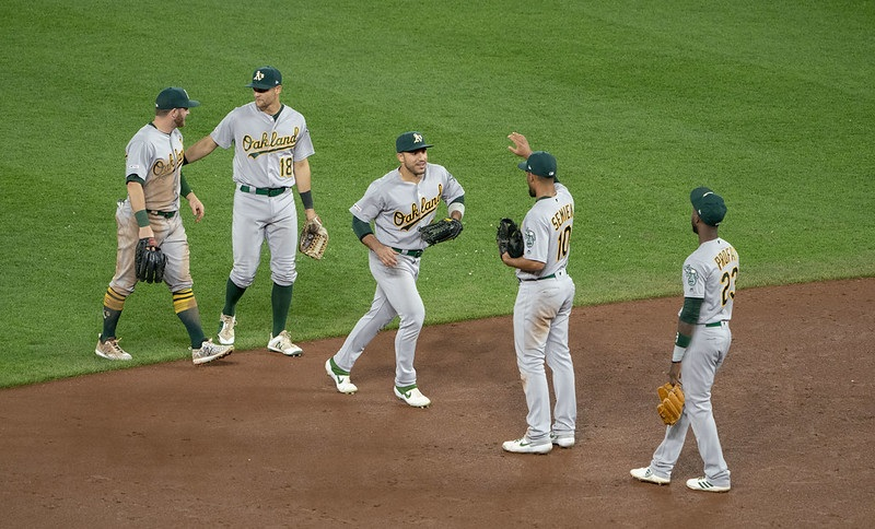 Photo of Oakland Athletics players on the field.
