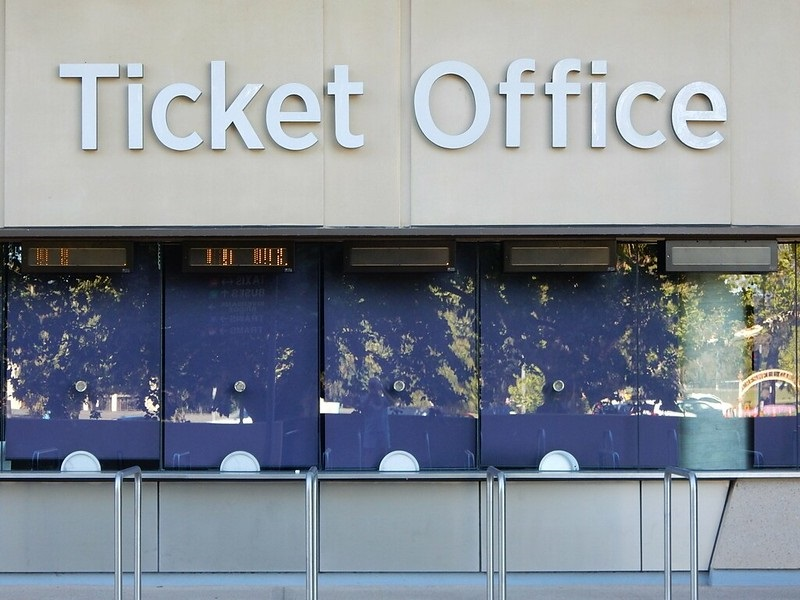 Stock photo of a ticket office outside of a large arena.
