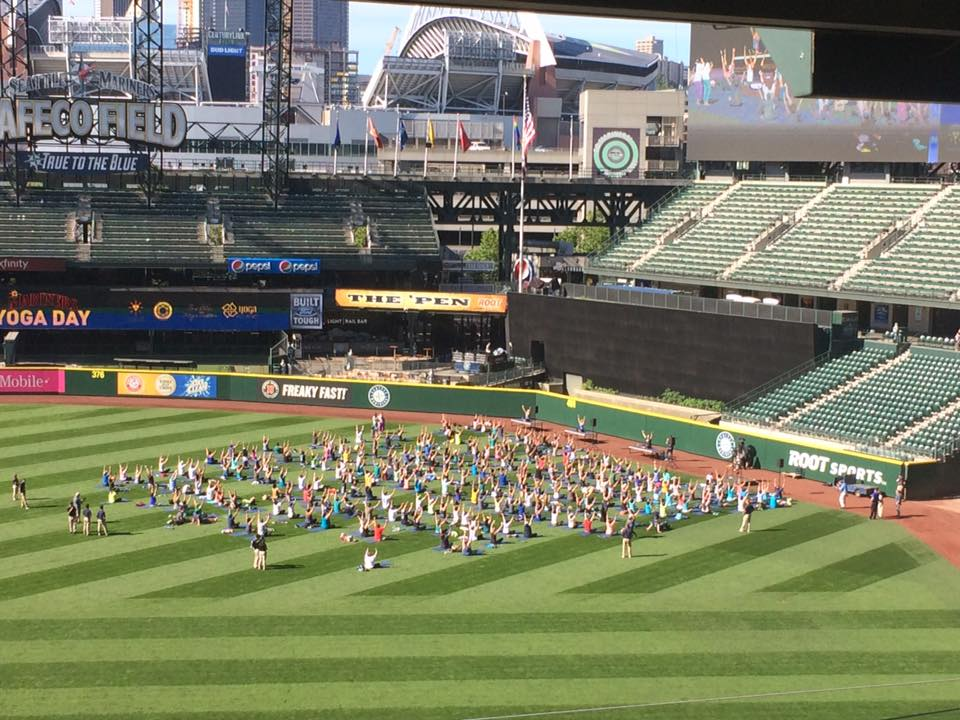 Photo of a yoga session at Safeco Field. Home of the Seattle Mariners.