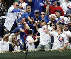 Photo of Chicago Cubs fans in the Wrigley Field bleachers.