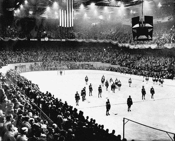 Black and white photo of the very first Boston Bruins home game at the Boston Garden.