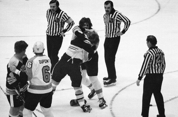 Black and white photo of Terry O'Reilly of the Boston Bruins fighting Dave Schulz of the Philadelphia Flyers.