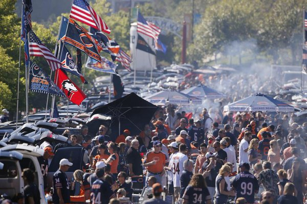 Photo of Chicago Bears fans tailgating.