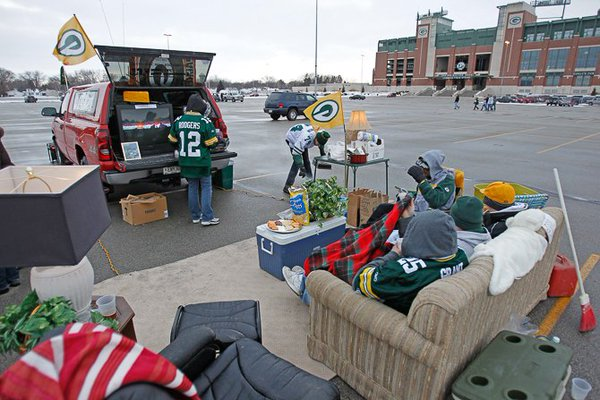 Photo of Green Bay Packers fans tailgating.