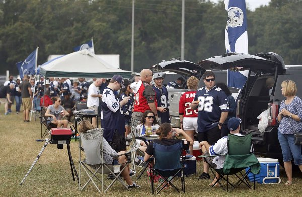 Photo of Dallas Cowboys fans tailgating.