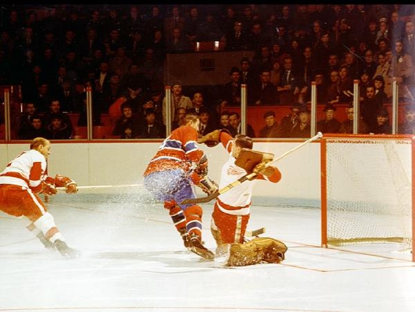 Photo of former Montreal Canadiens legend and center Jean Beliveau scoring on the Detroit Red Wings.