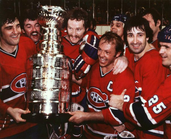 Old photo of the Montreal Canadiens celebrating one of their many Stanley Cup victories.