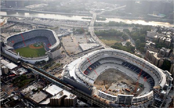 Photo of an aerial view of old Yankee Stadium and new Yankee Stadium side by side.