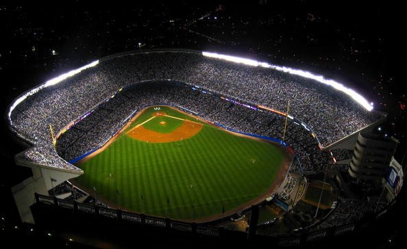 An aerial view of old Yankee Stadium during a night game.