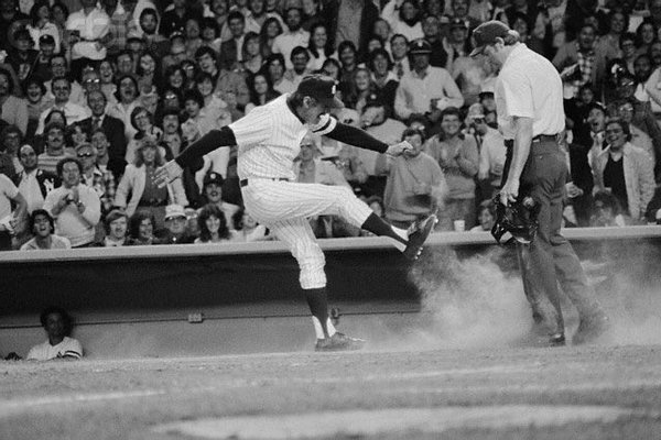 Photo of former New York Yankees manager Billy Martin letting an umpire have it.