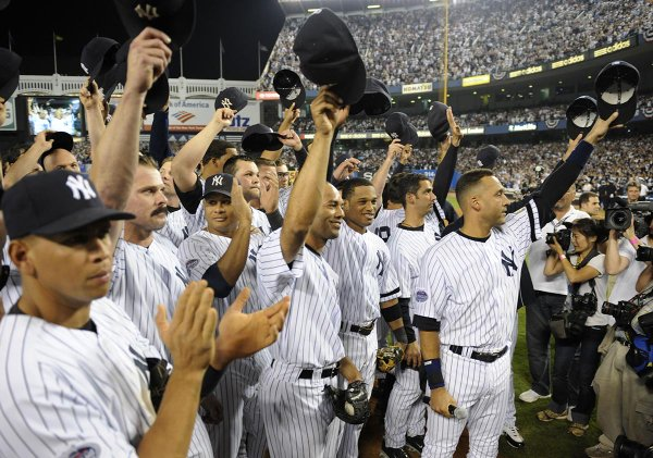 Photo of New York Yankees players saluting the Yankees fans following the final home game at old Yankee Stadium.