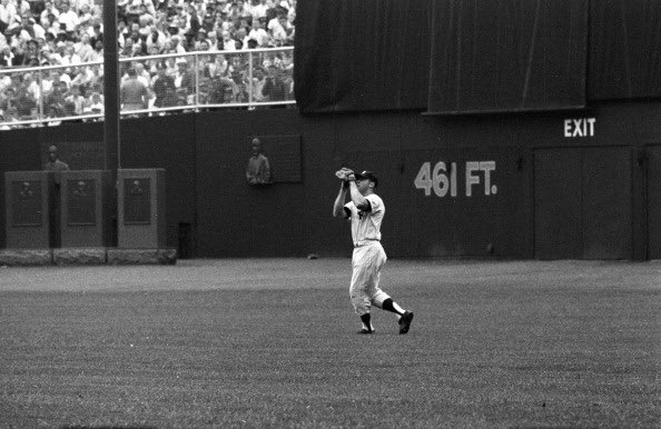 New York Yankees center fielder Mickey Mantle in action at old Yankee Stadium.