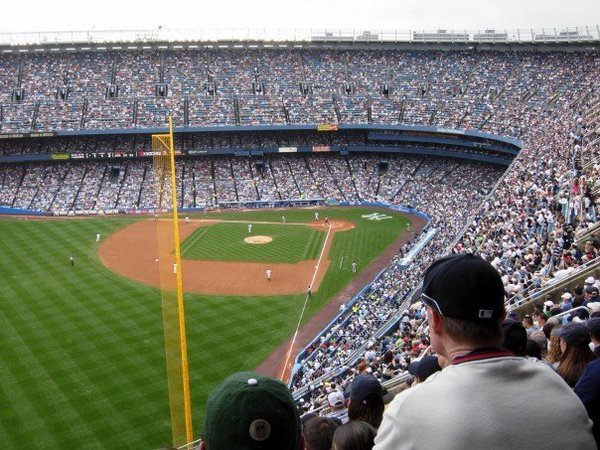 Photo of an obstructed view of the playing field from upper left field at old Yankee Stadium.