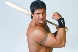 Jose Canseco flexing.