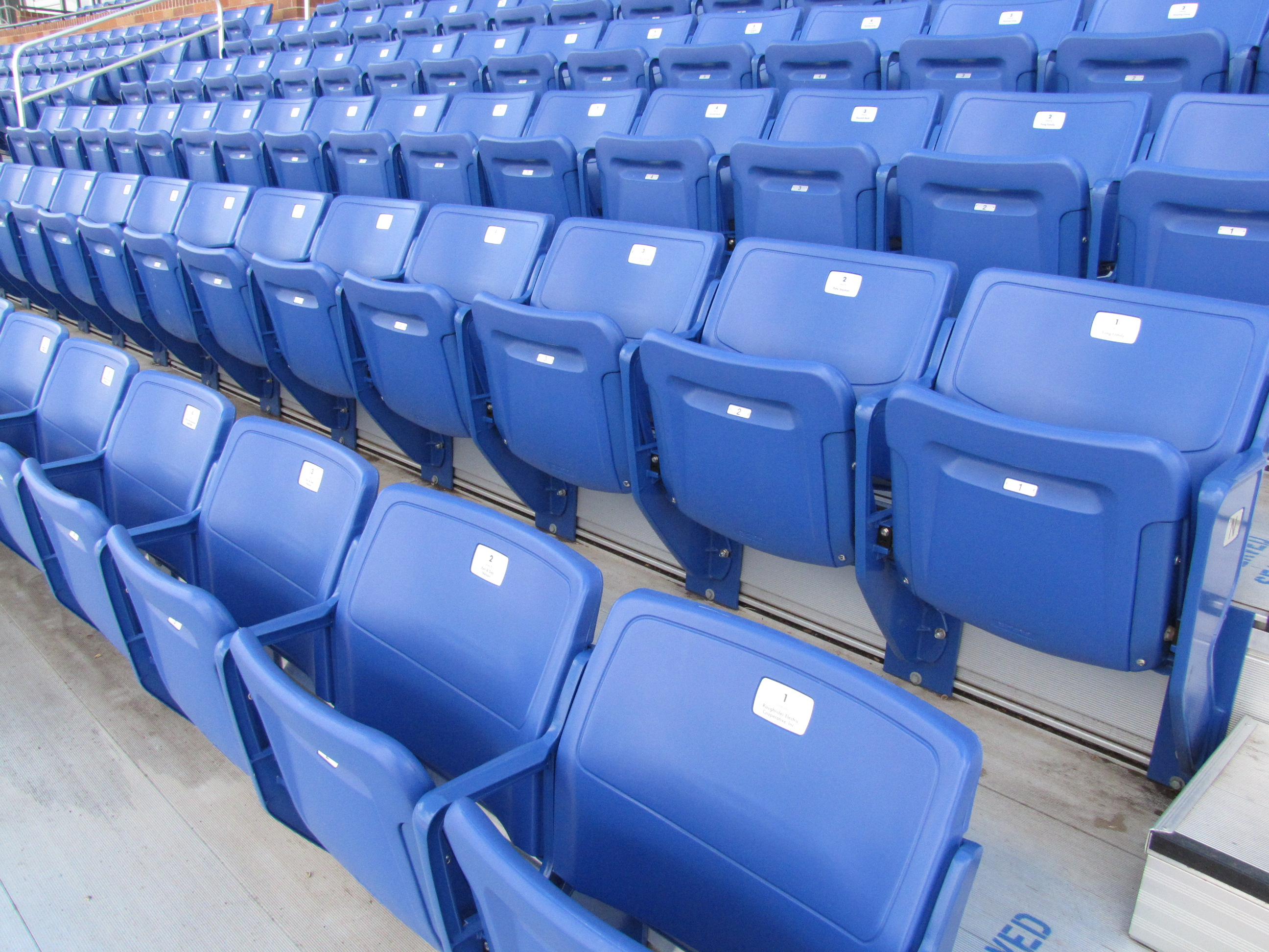 Stock photo of empty seats at an outdoor stadium.