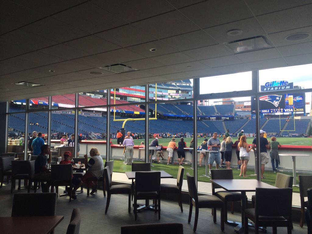 Interior photo of the Optum Club Lounge at Gillette Stadium, home of the New England Patriots.