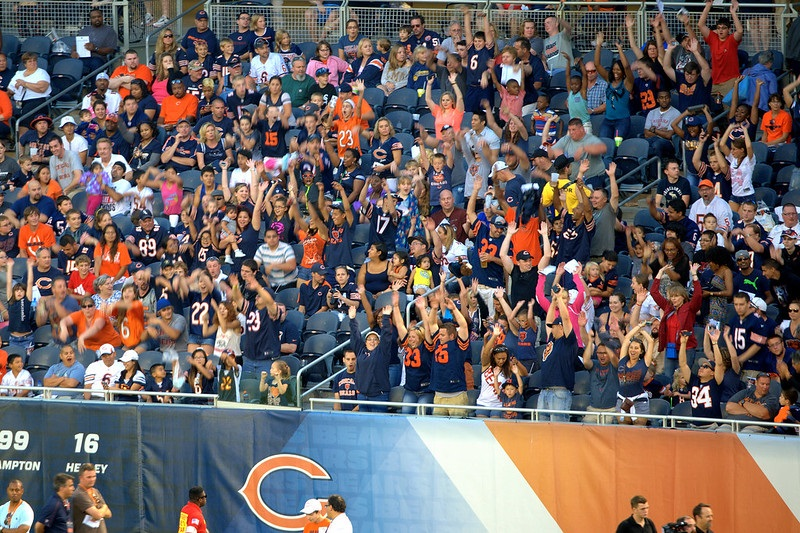 Photo of Chicago Bears fans cheering at Soldier Field during a Chicago Bears home game.
