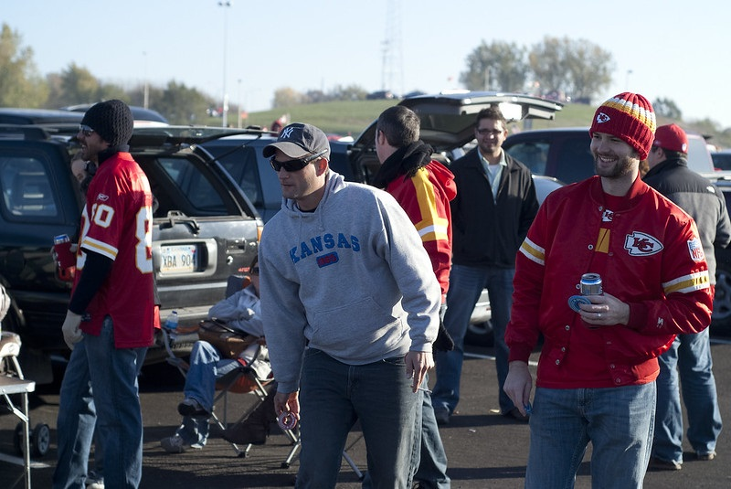 Photo of Kansas City Chiefs fans tailgating outside of Arrowhead Stadium.