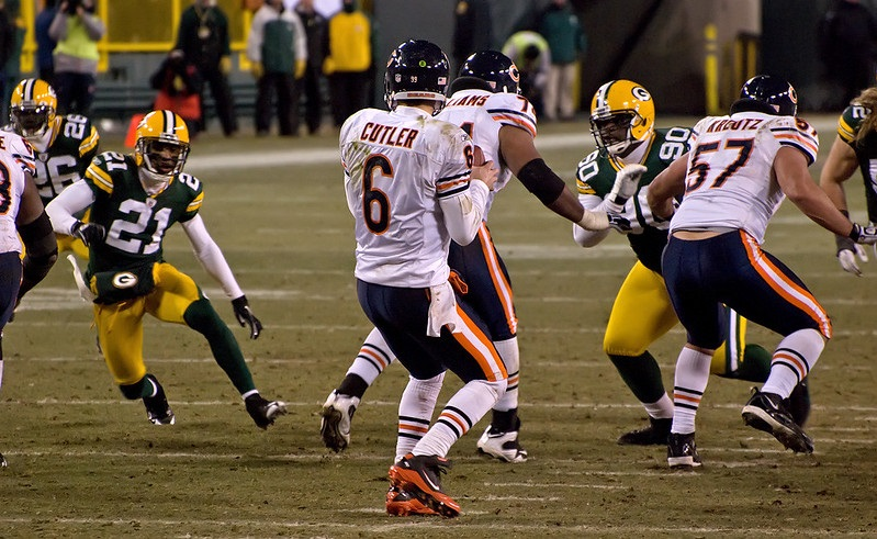 Photo of Jay Cutler of the Chicago Bears dropping back to complete a pass versus the Green Bay Packers.